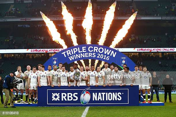 Dylan Hartley of England celebrates with team mates and the Triple Crown trophy after the RBS Six Nations match between England and Wales at...