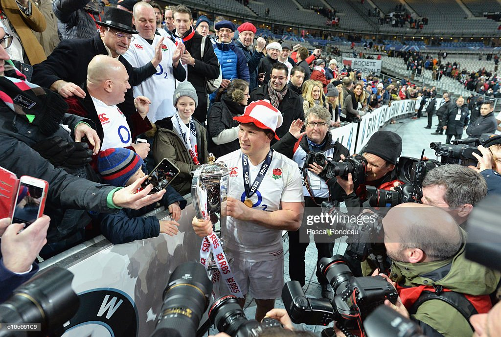 <a gi-track='captionPersonalityLinkClicked' href=/galleries/search?phrase=Dylan+Hartley&family=editorial&specificpeople=764177 ng-click='$event.stopPropagation()'>Dylan Hartley</a> of England holds the RBS Six Nations trophy after England won the Grand Slam during the RBS Six Nations match between France and England at Stade de France on March 19, 2016 in Paris, France.