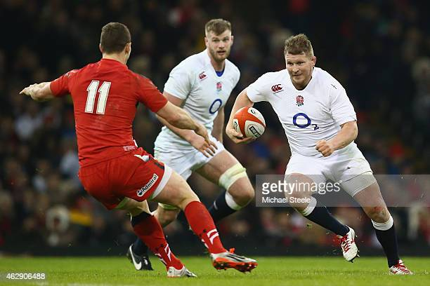 Dylan Hartley of England runs at George North of Wales during the RBS Six Nations match between Wales and England at the Millennium Stadium on...