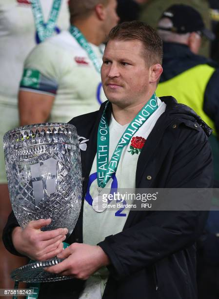 Dylan Hartley of England with the Cook Cup after victory in the Old Mutual Wealth Series match between England and Australia at Twickenham Stadium on...