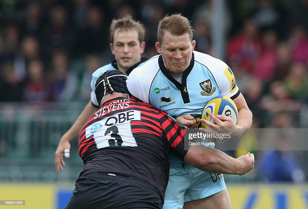 <a gi-track='captionPersonalityLinkClicked' href=/galleries/search?phrase=Dylan+Hartley&family=editorial&specificpeople=764177 ng-click='$event.stopPropagation()'>Dylan Hartley</a> of Northampton is tackled by <a gi-track='captionPersonalityLinkClicked' href=/galleries/search?phrase=Matt+Stevens&family=editorial&specificpeople=209047 ng-click='$event.stopPropagation()'>Matt Stevens</a> during the Aviva Premiership semi final match between Saracens and Northampton Saints at Allianz Park on May 12, 2013 in Barnet, England.