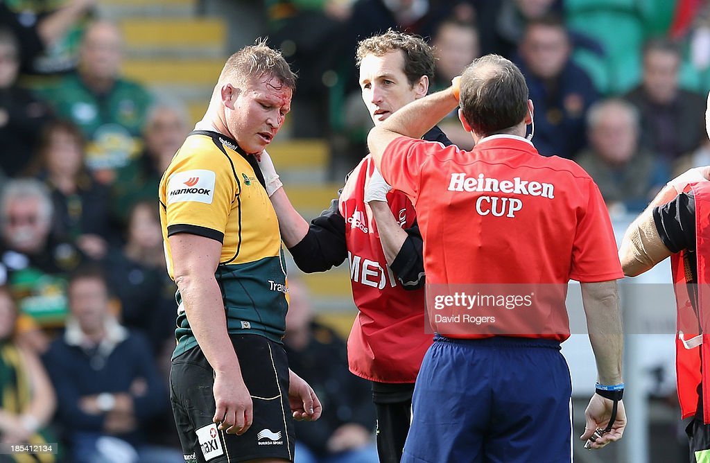 Dylan Hartley of Northampton receives attention to a cut forehead during the Heineken Cup pool 1 match between Northampton Saints and Ospreys at Franklin's Gardens on October 20, 2013 in Northampton, England.