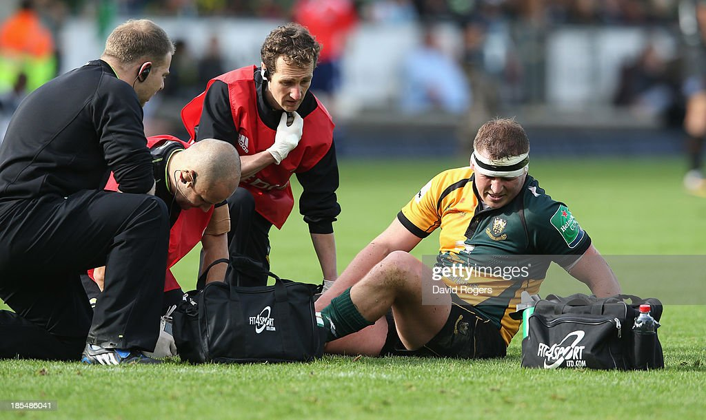 <a gi-track='captionPersonalityLinkClicked' href=/galleries/search?phrase=Dylan+Hartley&family=editorial&specificpeople=764177 ng-click='$event.stopPropagation()'>Dylan Hartley</a> of Northampton receives attention to an injured ankle during the Heineken Cup pool 1 match between Northampton Saints and Ospreys at Franklin's Gardens on October 20, 2013 in Northampton, England.