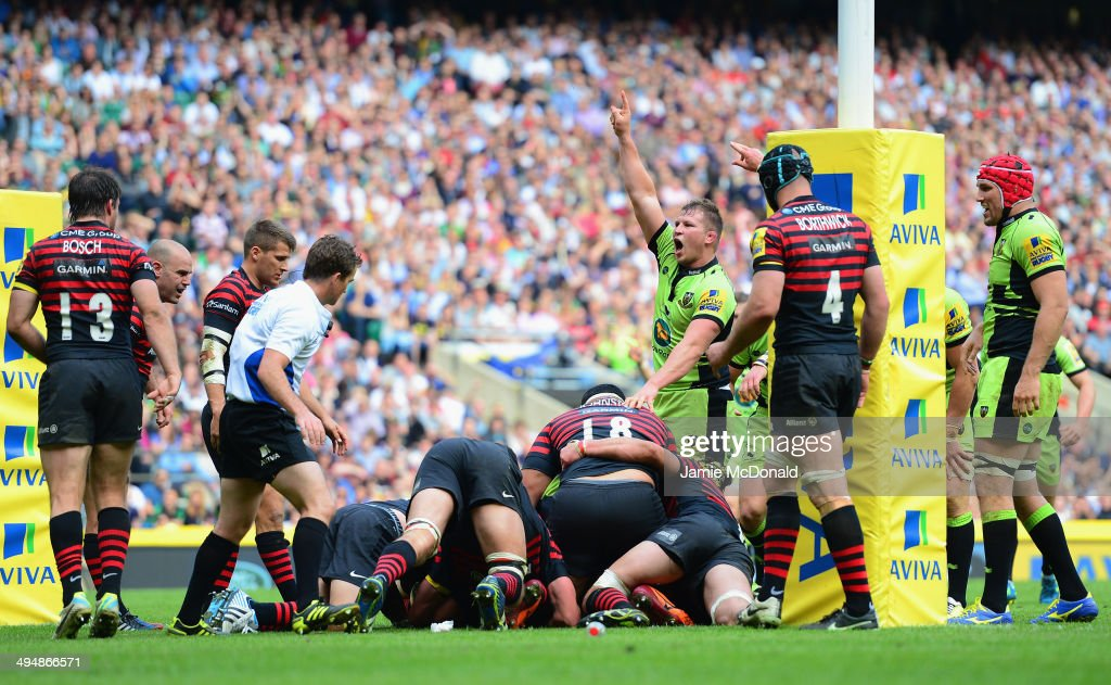 Dylan Hartley of Northampton Saints celebrates as Alex Waller of Northampton Saints goes over to score the winning try in extra time during the Aviva...