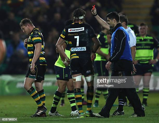 Dylan Hartley of Northampton walks off the pitch after being shown the red card by referee Jerome Garces during the European Rugby Champions Cup...