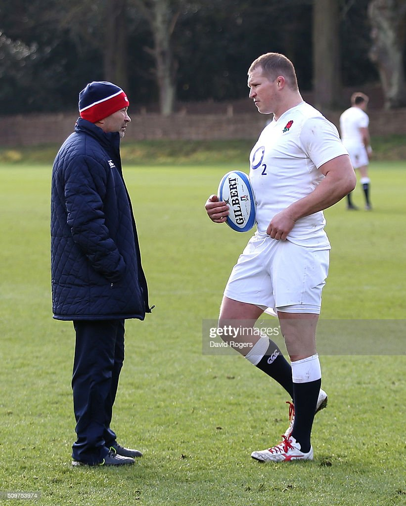 Dylan Hartley (R) the England captain, talks to head coach Eddie Jones during the England training session held at Pennyhill Park on February 12, 2016 in Bagshot, England.