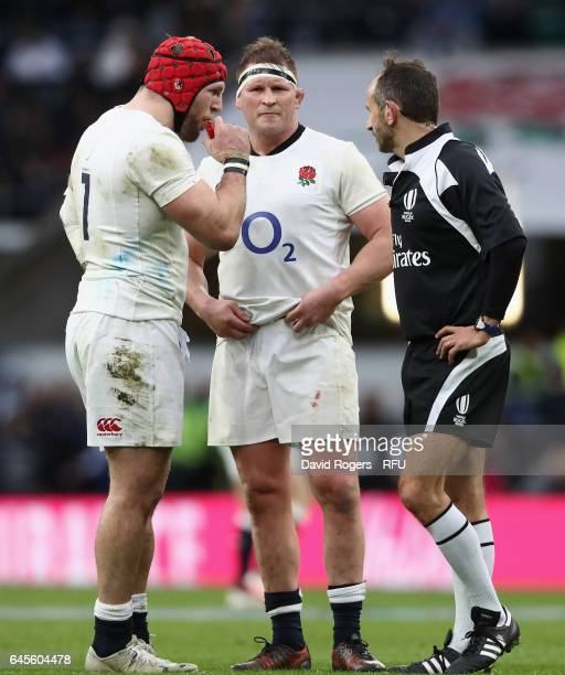 Dylan Hartley the England captain talks to referee Romain Poite as team mate James Haskell looks on during the RBS Six Nations match between England...