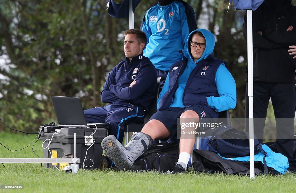 Dylan Hartley, the England hooker, looks on with his right ankle in a protective boot looks on during the England training session held at West Park Leeds Rugby Club on October 23, 2013 in Leeds, England.