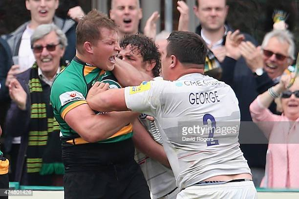 Dylan Hartley the Northampton Saints captain tustles with Jamie George and Jacques Burger during the Aviva Premiership play off semi final match...