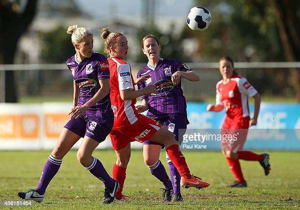 Dylan Holmes of Adelaide contests for the ball against Gabrielle Marzano and Collette McCallum of the Glory during the round three WLeague match...