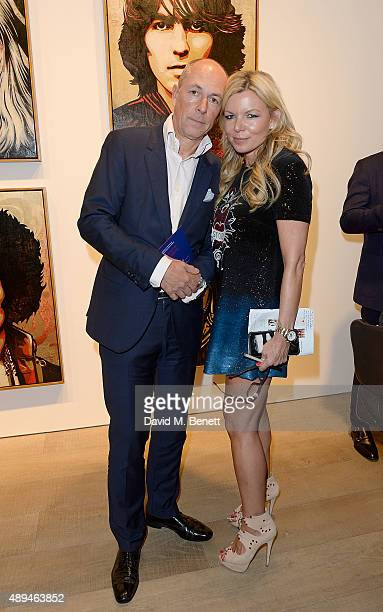 Dylan Jones and Fru Tholstrup attend a private view of 'Rock Style' a new exhibition curated by Tommy Hilfiger and Jeffrey Deitch at Sotheby's on...