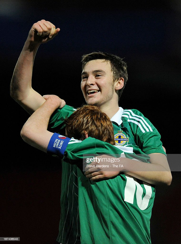 Dylan King (L) and Shea Gordan of Northern Ireland U16 celebrate victory after the Victory Shield match between England U16 and Northern Ireland U16 at Goldsands Stadium on November 8, 2013 in Bournemouth, England.