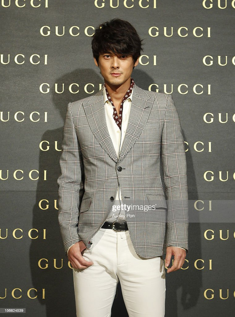 Dylan Kuo poses for a photograph at the Gucci Flagship store opening at Taipei101 on November 22, 2012 in Taipei, Taiwan.