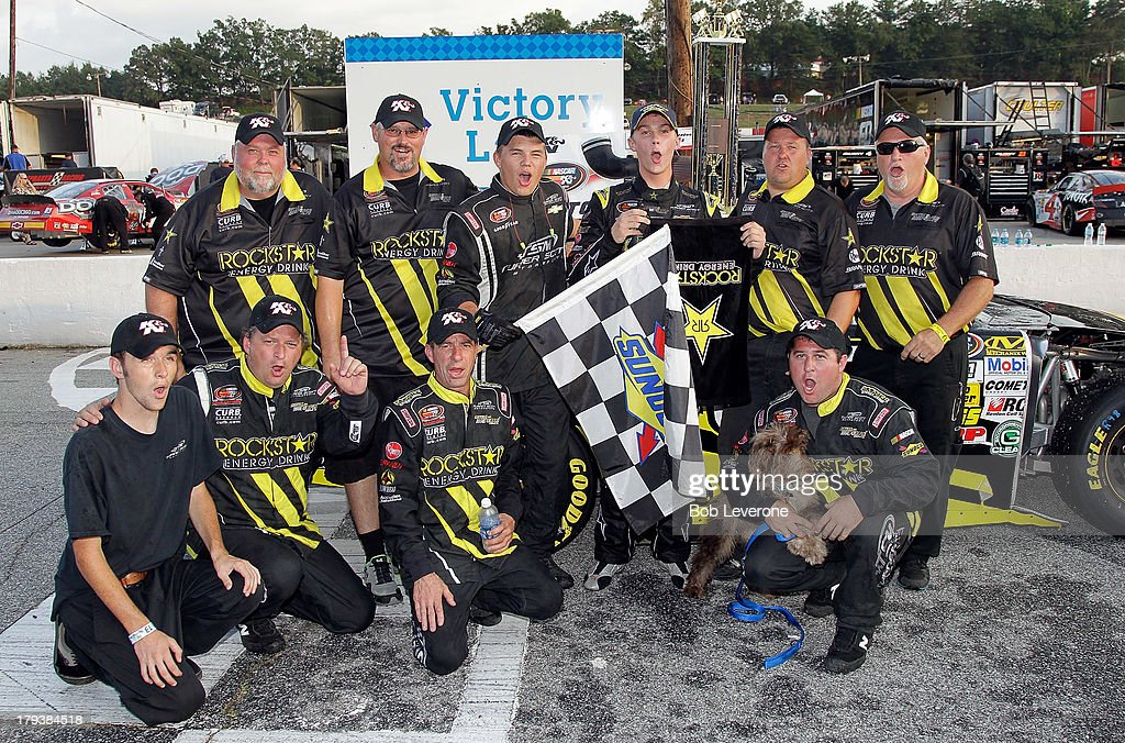 Dylan Kwasniewski and his Royal Purple/Rockstar Energy Drink Chevrolet pit crew pose for photos in Victory Lane at Greenville Pickens Speedway on September 2, 2013 in Greenville, South Carolina.