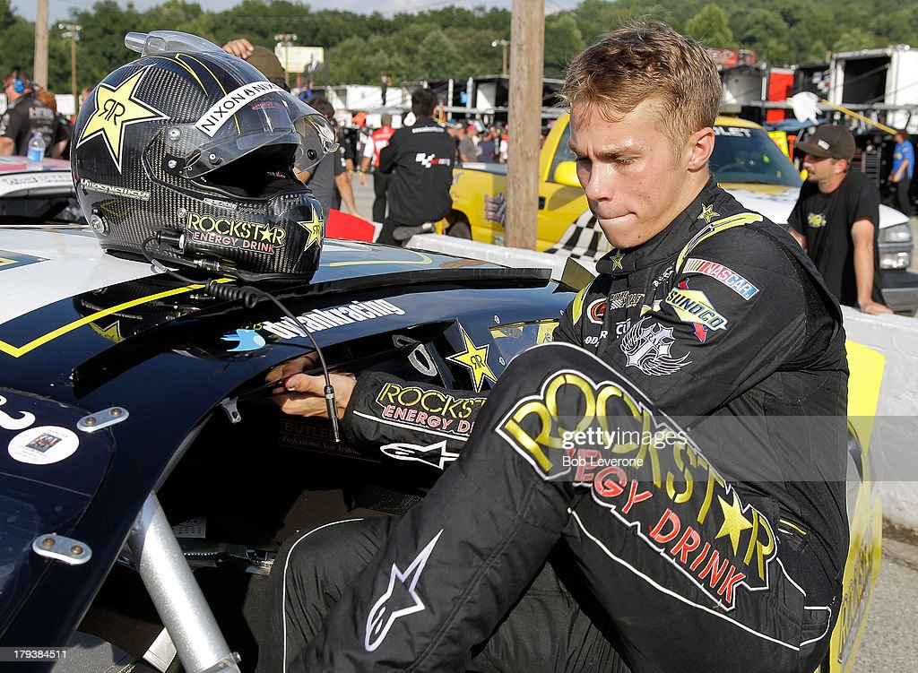 Dylan Kwasniewski climbs aboard his Royal Purple/Rockstar Energy Drink Chevrolet before the green flag at Greenville Pickens Speedway on September 2, 2013 in Greenville, South Carolina.
