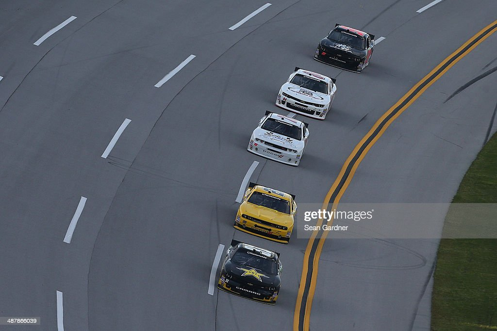 Dylan Kwasniewski driver of the Rockstar Chevrolet leads a pack of cars during qualifying for the NASCAR Nationwide Series Aaron's 312 at Talladega...