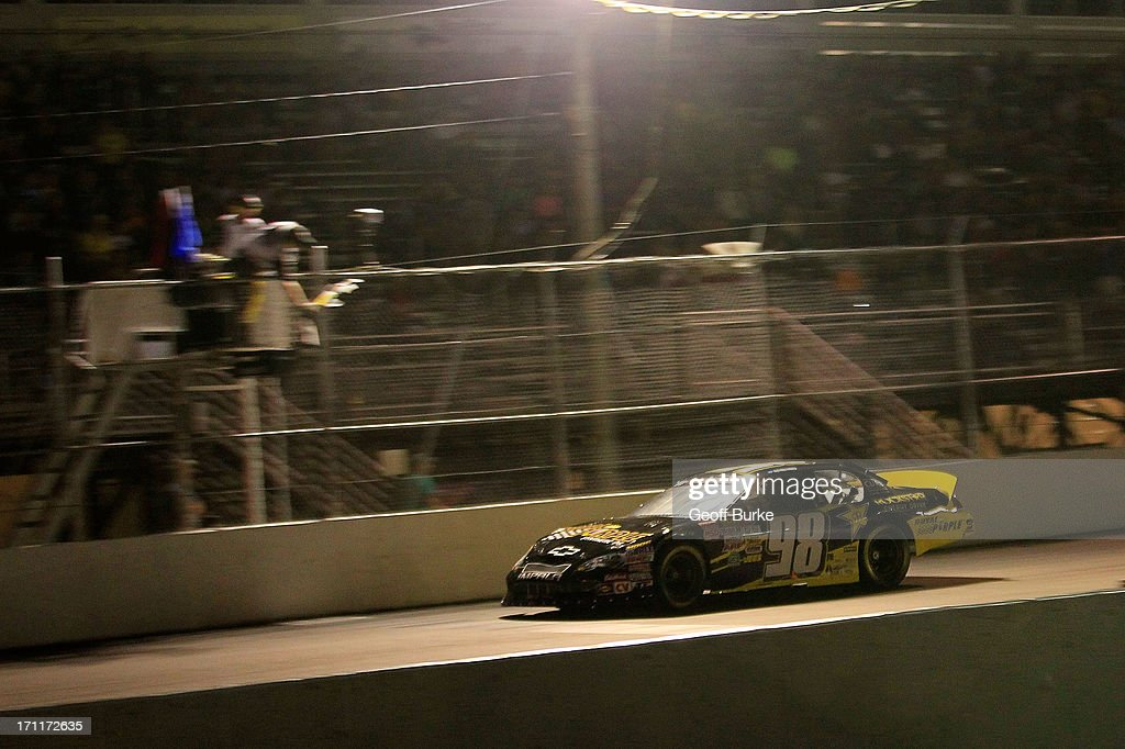 Dylan Kwasniewski, driver of the #98 Royal Purple/Rockstar Energy Drink Chevrolet, crosses the finish line to win the NASCAR K&N Pro Series East Visit Hampton VA 175 at Langley Speedway on June 22, 2013 in Langley, Virginia.