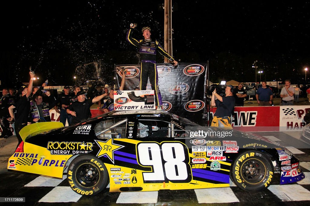 Dylan Kwasniewski, driver of the #98 Royal Purple/Rockstar Energy Drink Chevrolet, celebrates in victory lane after winning the NASCAR K&N Pro Series East Visit Hampton VA 175 at Langley Speedway on June 22, 2013 in Langley, Virginia.