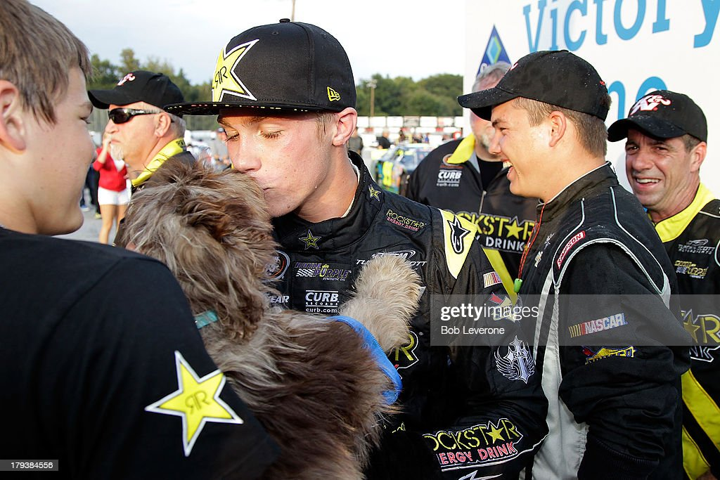 Dylan Kwasniewski kisses his dog, Ziggy after winning the Kevin Whitaker Chvrolet 140 at Greenville Pickens Speedway on September 2, 2013 in Greenville, South Carolina.