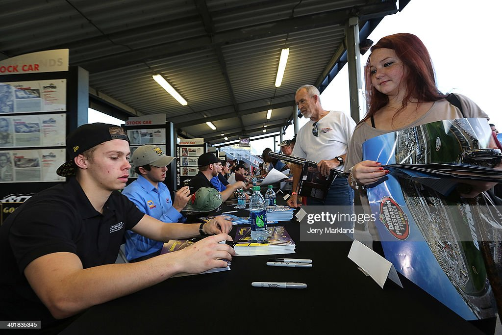 Dylan Kwasniewski signs autographs at the NASCAR Nationwide Series Preseason Thunder at Daytona International Speedway on January 11, 2014 in Daytona Beach, Florida.