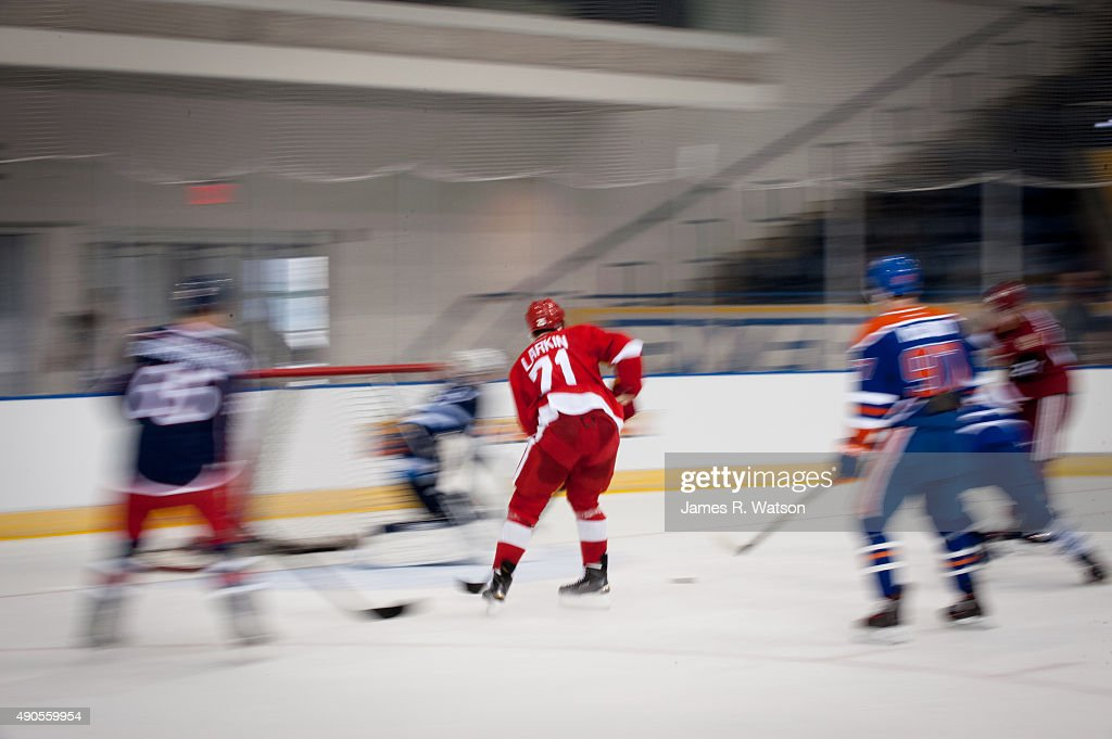Dylan Larkin (C) #71 of the Detroit Red Wings skates towards goal during a photo shoot at the 2015 NHLPA Rookie Showcase at Mattamy Athletic Centre on September 1, 2015 in Toronto , Ontario , Canada .