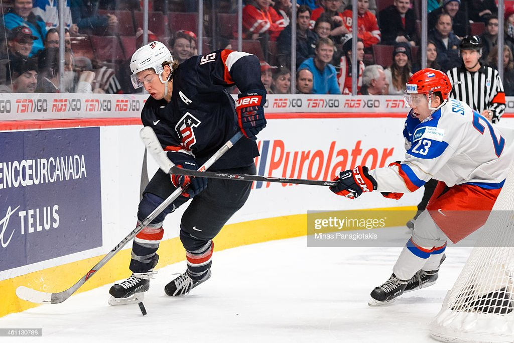 <a gi-track='captionPersonalityLinkClicked' href=/galleries/search?phrase=Dylan+Larkin&family=editorial&specificpeople=12867695 ng-click='$event.stopPropagation()'>Dylan Larkin</a> #21 of Team United States tries to play the puck with Alexander Sharov #23 of Team Russia close behind in a quarterfinal round during the 2015 IIHF World Junior Hockey Championships at the Bell Centre on January 2, 2015 in Montreal, Quebec, Canada. Team Russia defeated Team United States 3-2.