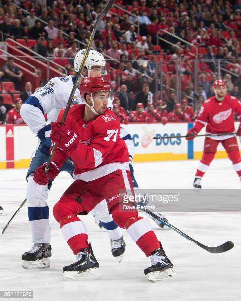 Dylan Larkin of the Detroit Red Wings battles for position with Victor Hedman of the Tampa Bay Lightning during an NHL game at Little Caesars Arena...