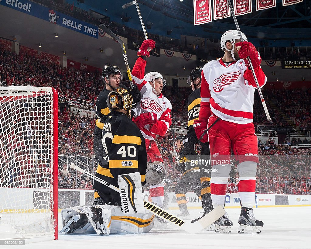 Dylan Larkin #71 of the Detroit Red Wings celebrates his first period goal with teammate Riley Sheahan #15 in front of Tuukka Rask #40, Dominic Moore #28 and Frank Vatrano #72 of the Boston Bruins during an NHL game at Joe Louis Arena on January 18, 2017 in Detroit, Michigan.