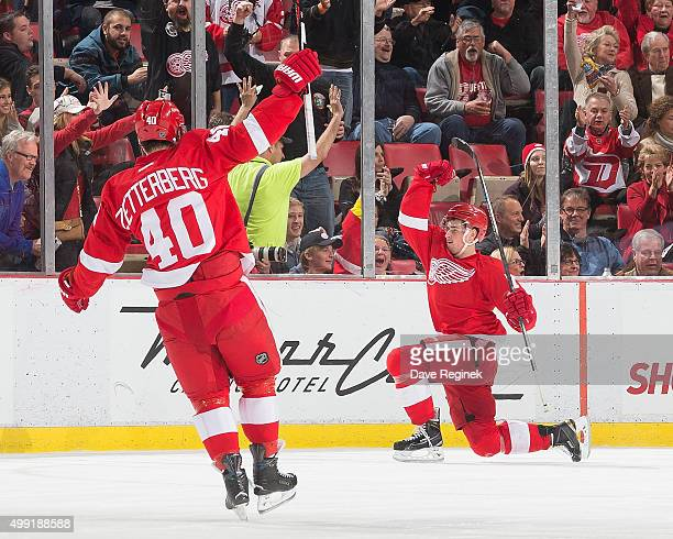 Dylan Larkin of the Detroit Red Wings celebrates his second period goal with teammate Henrik Zetterberg during an NHL game against the Florida...
