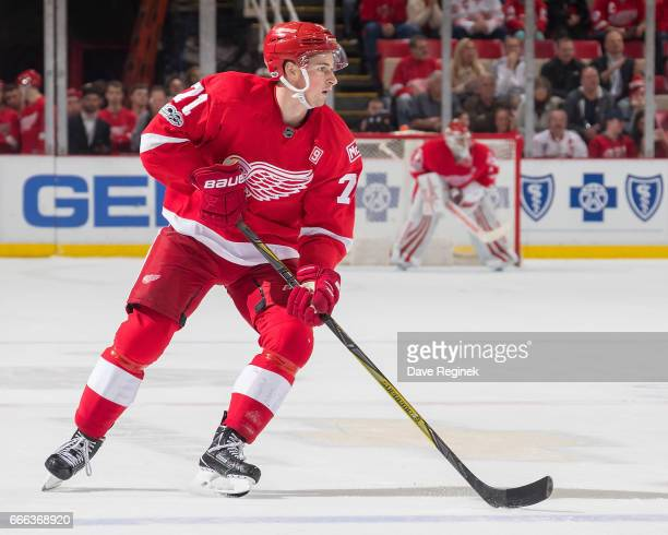 Dylan Larkin of the Detroit Red Wings ''controls the puck against the Ottawa Senators during an NHL game at Joe Louis Arena on April 3 2017 in...