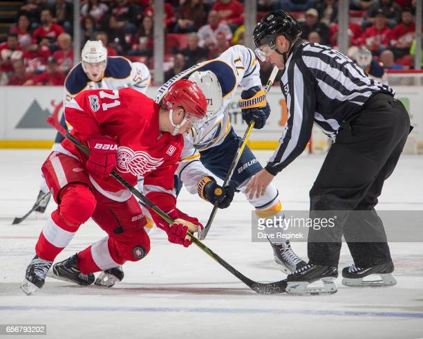 Dylan Larkin of the Detroit Red Wings faces off against Evan Rodrigues of the Buffalo Sabres during an NHL game at Joe Louis Arena on March 20 2017...