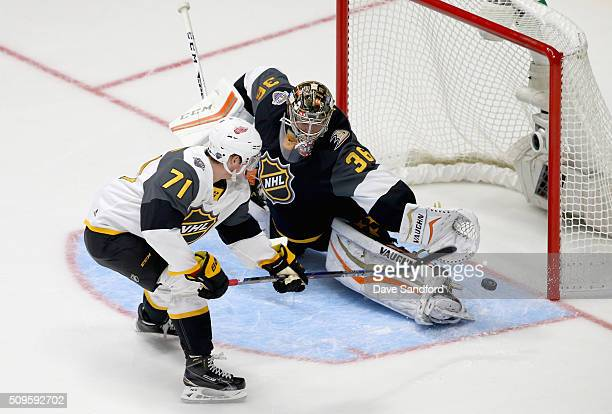 Dylan Larkin of the Detroit Red Wings gets past goaltender John Gibson of the Anaheim Ducks during the 2016 Honda NHL AllStar Final Game between the...