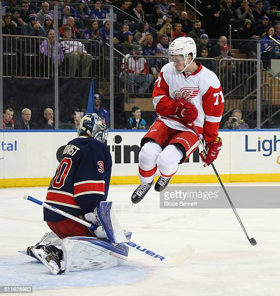 Dylan Larkin of the Detroit Red Wings jumps to screen Henrik Lundqvist of the New York Rangers during the first period at Madison Square Garden on...