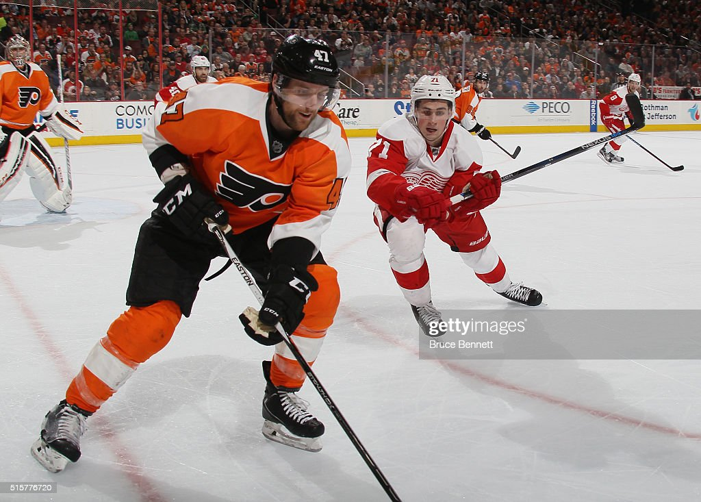 Dylan Larkin #71 of the Detroit Red Wings moves in to check Andrew MacDonald #47 of the Philadelphia Flyers during the third period at the Wells Fargo Center on March 15, 2016 in Philadelphia, Pennsylvania. The Flyers defeated the Red Wings 4-3.