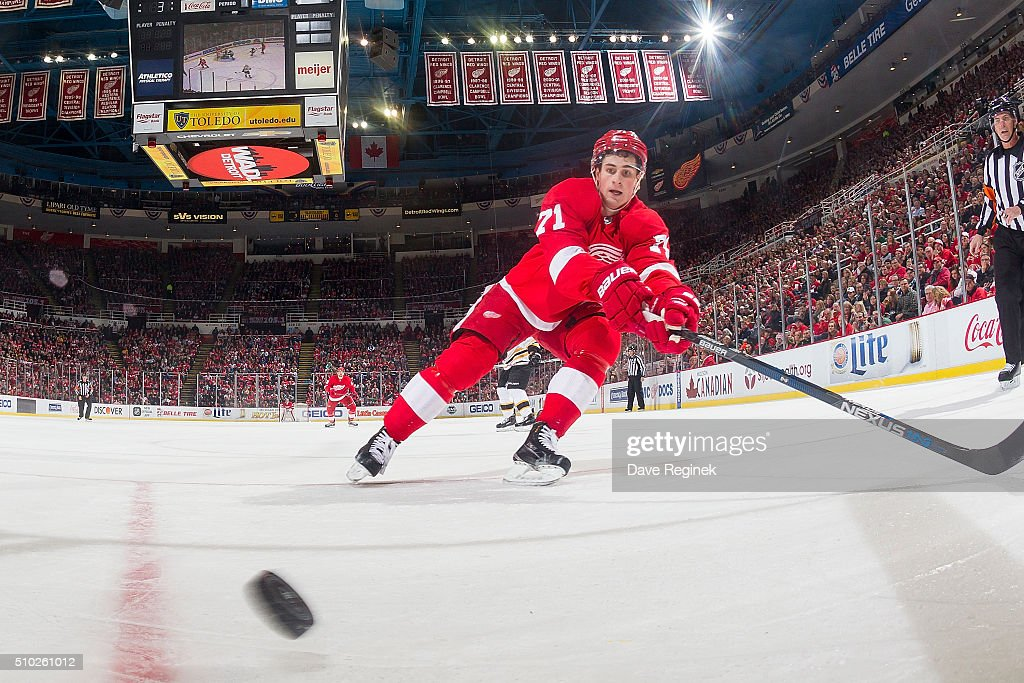 <a gi-track='captionPersonalityLinkClicked' href=/galleries/search?phrase=Dylan+Larkin&family=editorial&specificpeople=12867695 ng-click='$event.stopPropagation()'>Dylan Larkin</a> #71 of the Detroit Red Wings reaches after a loose puck during an NHL game against the Boston Bruins at Joe Louis Arena on February 14, 2016 in Detroit, Michigan.