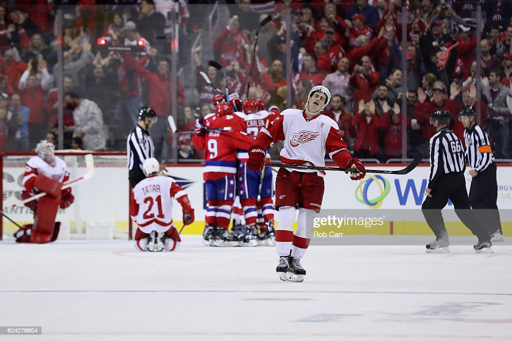 Dylan Larkin #71 of the Detroit Red Wings reacts as the Washington Capitals celebrate scoring a third period goal during the Capitals 1-0 win at Verizon Center on November 18, 2016 in Washington, DC.