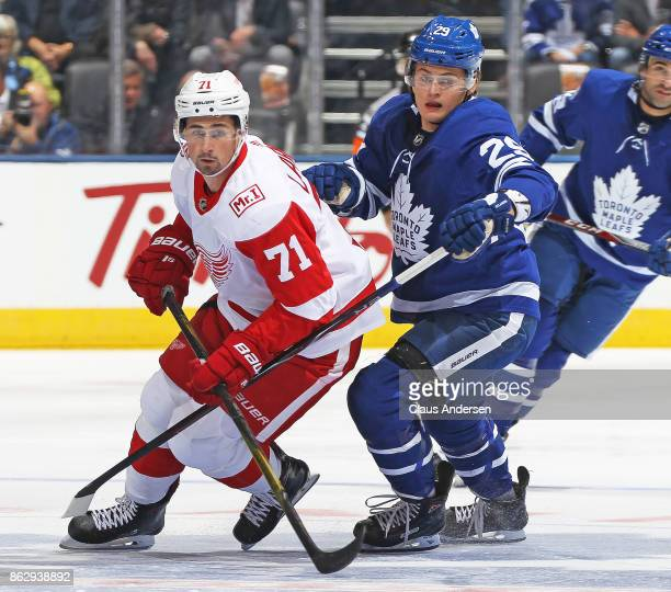 Dylan Larkin of the Detroit Red Wings skates against William Nylander of the Toronto Maple Leafs in an NHL game at the Air Canada Centre on October...