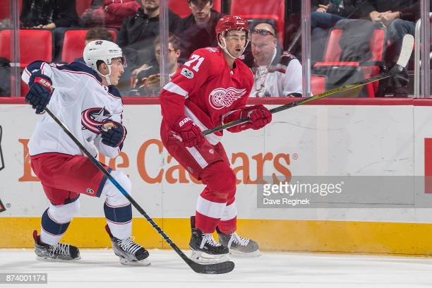 Dylan Larkin of the Detroit Red Wings skates in front of Zach Werenski of the Columbus Blue Jackets during an NHL game at Little Caesars Arena on...