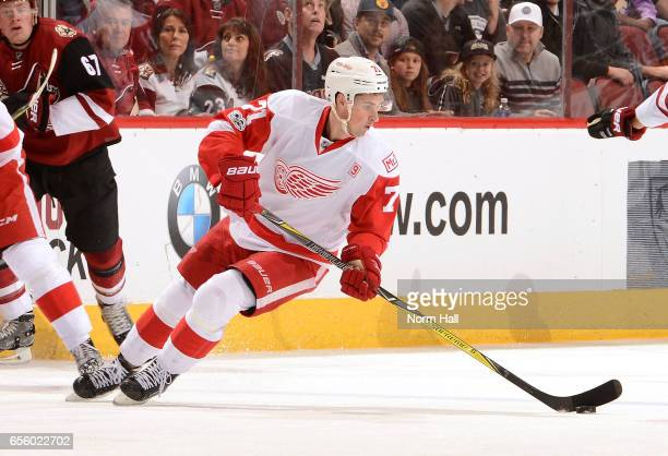Dylan Larkin of the Detroit Red Wings skates the puck up ice against the Arizona Coyotes at Gila River Arena on March 16 2017 in Glendale Arizona