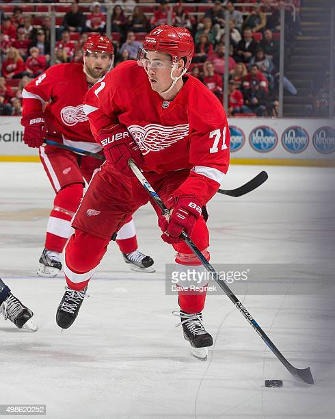Dylan Larkin of the Detroit Red Wings skates up ice with the puck during an NHL game against the Washington Capitals at Joe Louis Arena on November...