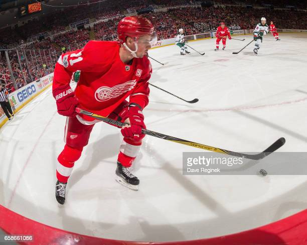 Dylan Larkin of the Detroit Red Wings skates with the puck against the Minnesota Wild during an NHL game at Joe Louis Arena on March 26 2017 in...