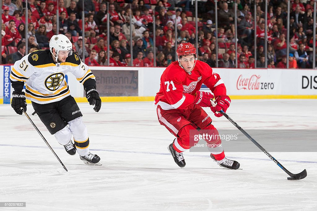 <a gi-track='captionPersonalityLinkClicked' href=/galleries/search?phrase=Dylan+Larkin&family=editorial&specificpeople=12867695 ng-click='$event.stopPropagation()'>Dylan Larkin</a> #71 of the Detroit Red Wings skates with the puck next to <a gi-track='captionPersonalityLinkClicked' href=/galleries/search?phrase=Ryan+Spooner&family=editorial&specificpeople=5617370 ng-click='$event.stopPropagation()'>Ryan Spooner</a> #51 of the Boston Bruins during an NHL game at Joe Louis Arena on February 14, 2016 in Detroit, Michigan.
