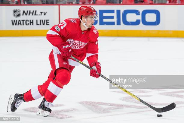 Dylan Larkin of the Detroit Red Wings turns up ice with the puck against the Washington Capitals during an NHL game at Little Caesars Arena on...