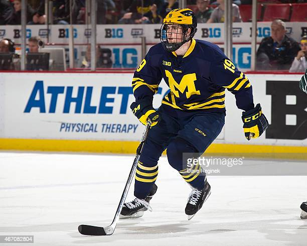 Dylan Larkin of the Michigan Wolverines follows the play against the Michigan State Spartans during game two of Big Ten Mens Ice Hockey Championship...