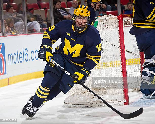 Dylan Larkin of the Michigan Wolverines skates around the net against the Minnesota Golden Gophers during the finals of Big Ten Mens Ice Hockey...