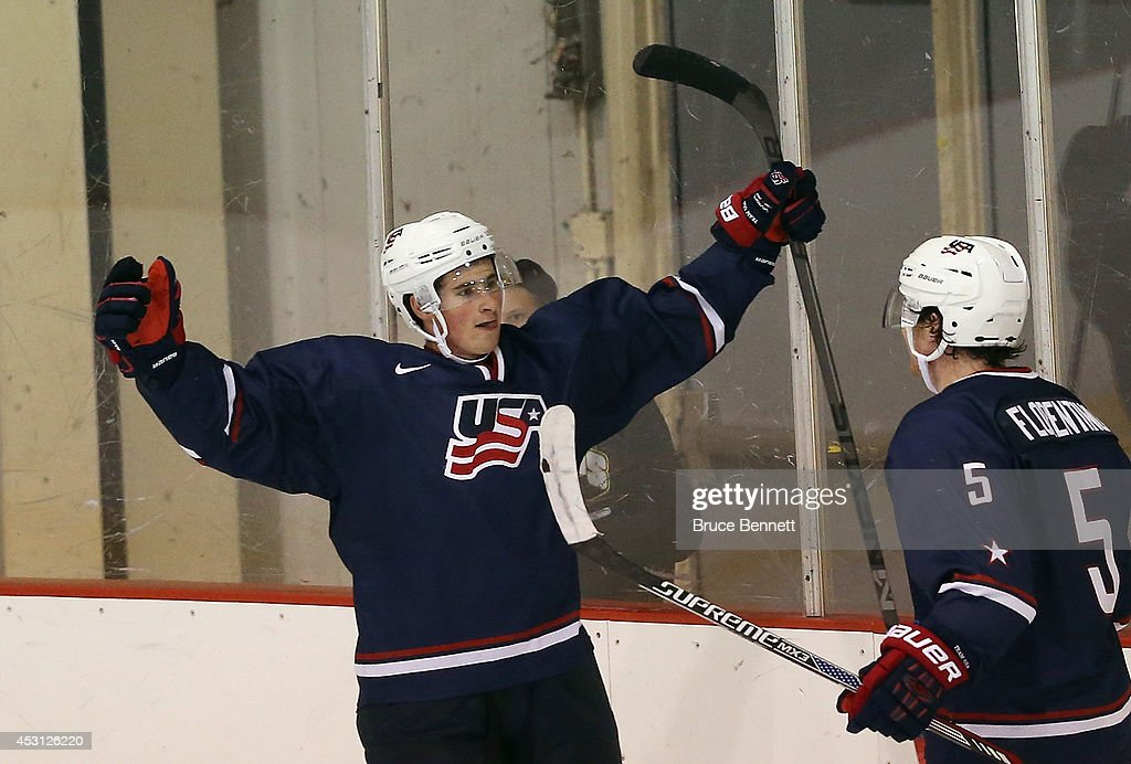 Dylan Larkin #16 of USA Blue celebrates his game winning goal at 18:55 of the third period against Team Finland during the 2014 USA Hockey Junior Evaluation Camp at the Lake Placid Olympic Center on August 3, 2014 in Lake Placid, New York. USA Blue defeated Team Finland 2-1.