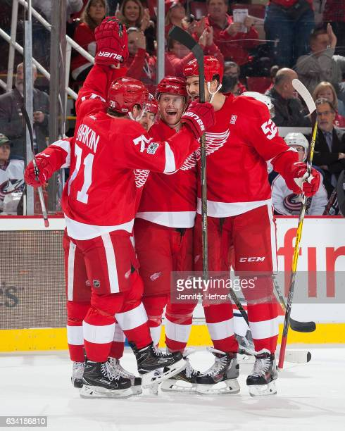 Dylan Larkin Tomas Tatar and Jonathan Ericsson of the Detroit Red Wings celebrate with teammate Nick Jensen after he scores the first goal of an NHL...