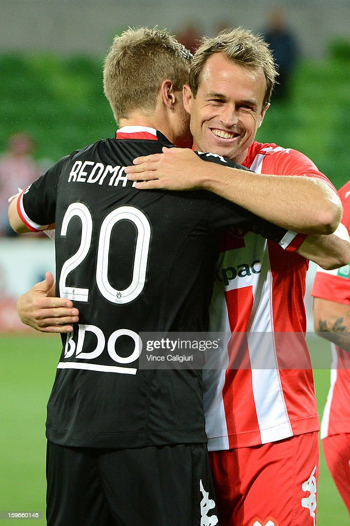 Dylan MaCallister hugs keeper Andrew Redmayne of the Heart after winning the round seventeen A-League match between Melbourne Heart and Adelaide United at AAMI Park on January 18, 2013 in Melbourne, Australia.