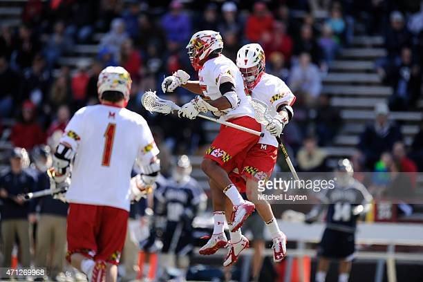 Dylan Maltz and Joe LoCascio of the Maryland Terrapins celerate a goal during a lacrosse game against the Penn State Nittany Lions at Capital One...