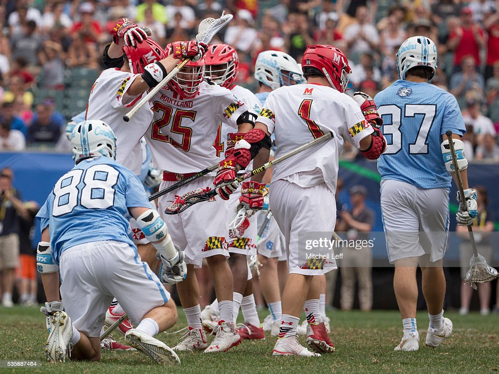 Dylan Maltz #25 of the Maryland Terrapins celebrates with his teammates after a goal in front of Kyle Mathie #88 of the North Carolina Tar Heels in the NCAA Division I Men's Lacrosse Championship at Lincoln Financial Field on May 30, 2016 in Philadelphia, Pennsylvania.